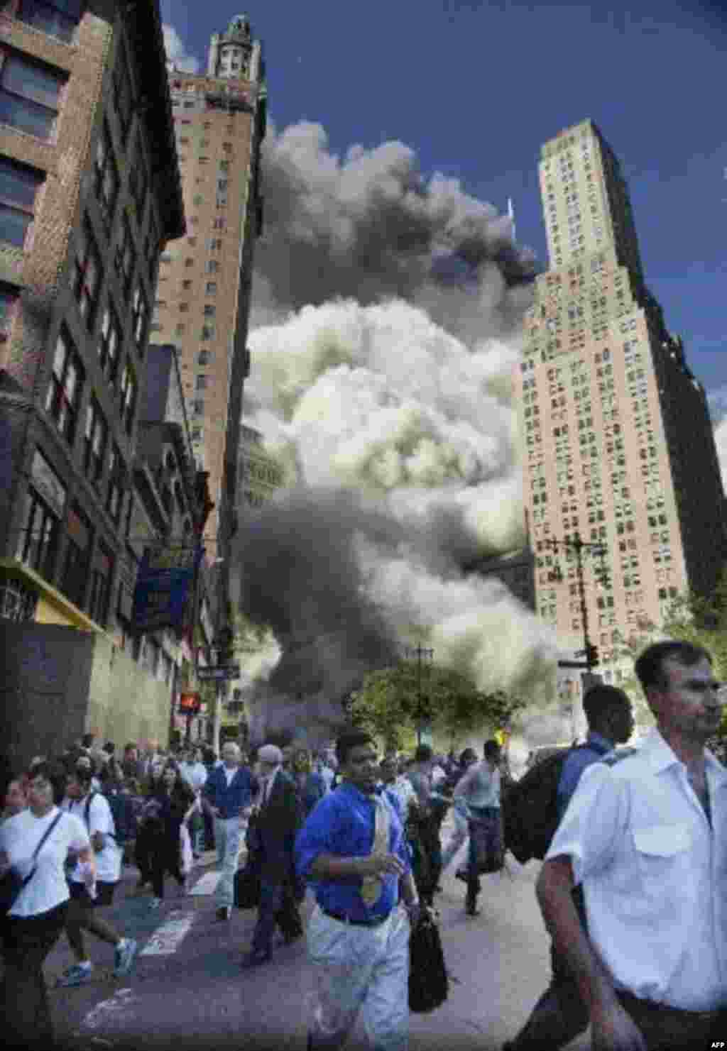 Pedestrians flee the area of the World Trade Center as the center's south tower collapses following a terrorist attack on the New York landmark Tuesday, Sept. 11, 2001. (AP Photo/Amy Sancetta) ITALY OUT