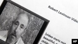 This copy photograph of a paper printout obtained by The Associated Press shows Robert Levinson. Long after he vanished in Iran, the retired FBI agent reappeared in a video and a series of photographs sent to his family over the past year, transforming a