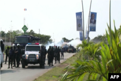 Protesters clash with police in the Rio district of Libreville, Gabon, August 31, 2016.