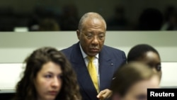 Former Liberian President Charles Taylor listens to the judge at the opening of the sentencing judgement hearing at the court in Leidschendam, near The Hague, May 30, 2012.