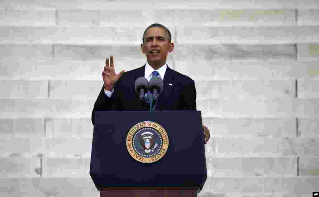 "U.S. President Barack Obama speaks during a ceremony marking the 50th anniversary of Martin Luther King Jr.'s ""I have a dream"" speech on the steps of the Lincoln Memorial in Washington, Aug. 28, 2013."