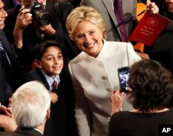 Hillary Clinton poses for a photo after debate.