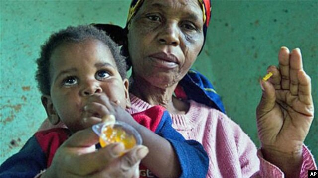 HIV positive child, Gift, no second name provided, is given some jam prior to her ARV medication by a caregiver near Durban South Africa, November 2010 (file photo)