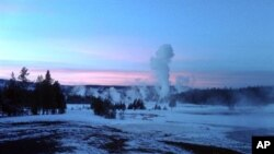 The Upper Geyser Basin at sunset in Yellowstone National Park, which extends across three western states: Wyoming, Montana and Idaho