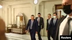 (SOLDAN SAĞA) Rusya Başbakan Yardımcısı Borisov, Rusya Dışişleri Bakanı Lavrov ve Suriye Devlet Başkanı Esat