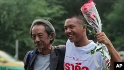 FILE - Thai law student Jatupat Boonpattararaksa, right, and his father Viboon Boonpattararaksa in Bangkok, Thailand.