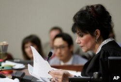 Judge Rosemarie Aquilina reads excerpts from the letter written by Larry Nassar during the seventh day of Nassar's sentencing hearing, Jan. 24, 2018, in Lansing, Mich. The former sports doctor admitted molesting some of the nation's top gymnasts for years.