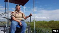 Betty Osceola, a member of the Miccosukee tribe, runs an airboat tour company in the Everglades, where persistent economic development threatens indigenous lands and sacred burial grounds. (W. Gallo/VOA)
