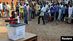 FILE - A man casts his vote at a polling station during presidential elections in Accra, Ghana, Dec. 7, 2012.