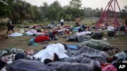"Dozens of Central American migrants, traveling with the annual ""Stations of the Cross"" caravan, sleep at a sports club in Matias Romero, Oaxaca State, Mexico, April 3, 2018."