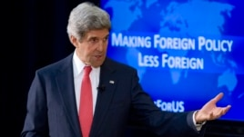 Secretary of State John Kerry speaks about foreign policy, including the situation in Ukraine, during a town hall meeting with university students, Tuesday, March 18, 2014, at the State Department in Washington.