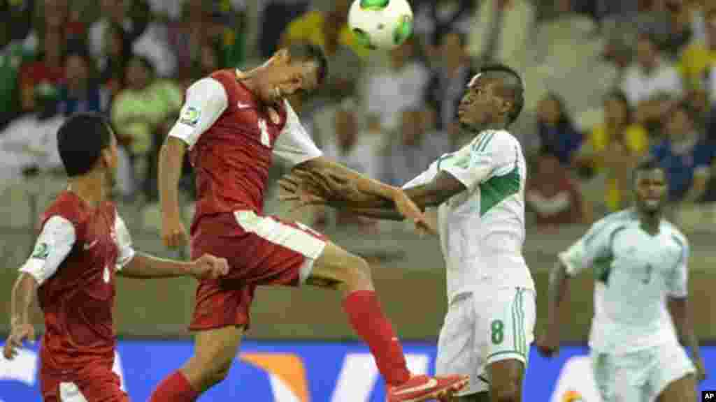 Tahiti's Ricky Aitamai, left, and Nigeria's Brown Ideye challenge for the ball during the Confederations Cup match between Tahiti and Nigeria.