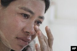 FILE - Burmese Ma Moe, who is infected with HIV, breaks into tears as she recalls how her husband died of AIDS. AIDS in Asia, has steadily worsened out of the spotlight, June 9, 2009.