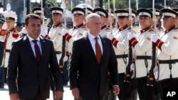 U.S. Defense Secretary James Mattis, center, and Macedonian Prime Minister Zoran Zaev walk past an honor guard at the government building in Skopje, Macedonia, Sept. 17, 2018. (AP Photo/Boris Grdanoski)