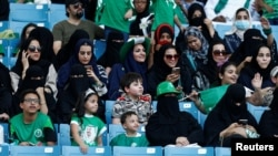 FILE - Saudi Arabian women attend a rally celebrating National Day, in Riyadh, Saudi Arabia, Sept. 23, 2017.