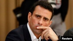 FILE - Venezuelan opposition leader Henrique Capriles attends a meeting with representatives of the opposition, the Roman Catholic Church and the Union of South American Nations (UNASUR) at Miraflores Place in Caracas, April 10, 2014.