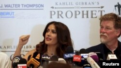 "Movie star Salma Hayek speaks during a news conference to promote her film ""The Prophet"" as writer and director Roger Allers (R) looks on, in Beirut, Lebanon, April 27, 2015"