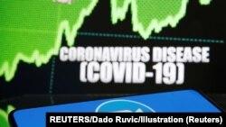 Zoom logo is seen in front of diplayed coronavirus disease (COVID-19)
