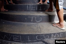 "FILE - ""Welcome to Hell"" is written on the stairs inside Quezon City Jail in Manila, Philippines Oct. 19, 2016."