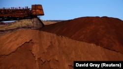 FILE - Mining company Rio Tinto shown unloading iron ore onto a pile at a mine located in the Pilbara region of Western Australia December 2, 2013.