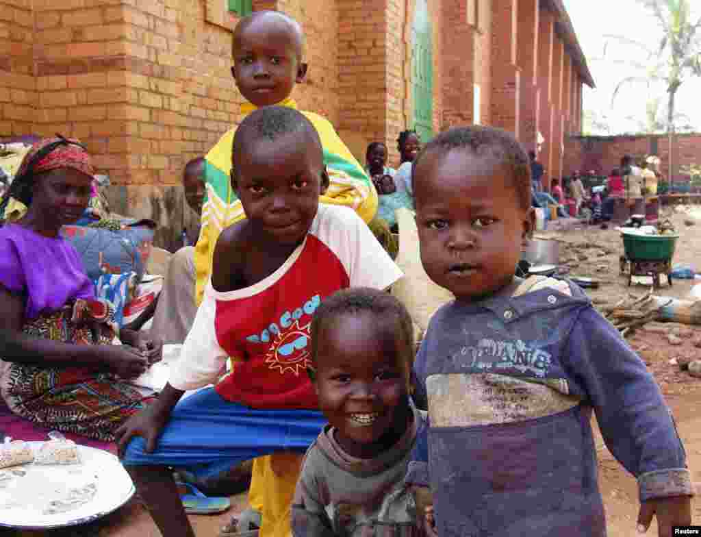 Internally displaced children escaping the violence pose at Saint Paul's Church, Bangui, Central African Republic, Dec. 17, 2013.