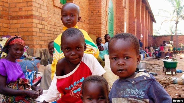 Internally displaced children, who are escaping the violence, pose at Bangui's Saint Paul's Church December 17, 2013. Some European countries will send troops to support a French-African mission to restore order in Central African Republic, French Foreign
