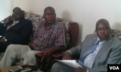 New War Veterans Minister Tshinga Dube (far left) seen here with fired minister Christopher Mutsvangwa on the day war veterans were engaged in street skirmishes with police in Harare.