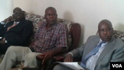 FILE: War Veterans Minister Tshinga Dube seen here with fired War Veterans Minister Christopher Mutsvangwa on the day war veterans were engaged in street skirmishes with police in Harare this year.