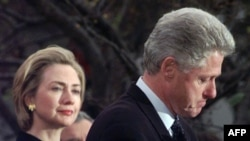 President Clinton thanks Democrats in the House of Representatives who opposed his impeachment, as first lady Hillary Rodham Clinton watches, on December 19, 1998