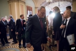 Senate Minority Leader Charles Schumer returns to the Senate chamber Tuesday after answering reporters' questions about President Trump.