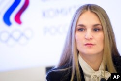 Russian fencer Sofiya Velikaya attends a news conference in Moscow, Russia, Dec. 12, 2017.