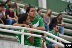 People pay tribute to the players of Brazilian team Chapecoense Real who were killed in a plane accident in the Colombian mountains, at the club's Arena Conda stadium in Chapeco, in the southern Brazilian state of Santa Catarina, Nov. 29, 2016.
