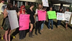 A protest last week in Topeka, Kansas, where investigations of domestic abuse cases have been threatened over budget cuts