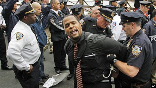 A protester reacts as he is arrested on the Brooklyn Bridge during an 'Occupy Wall Street' protest in New York October 1, 2011.