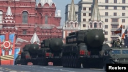 Russian mobile Topol-M missile launching units drive in formation during the Victory Day parade in Moscow's Red Square May 9, 2014. Russia celebrates the 1945 victory over Nazi Germany during World War II every May 9.