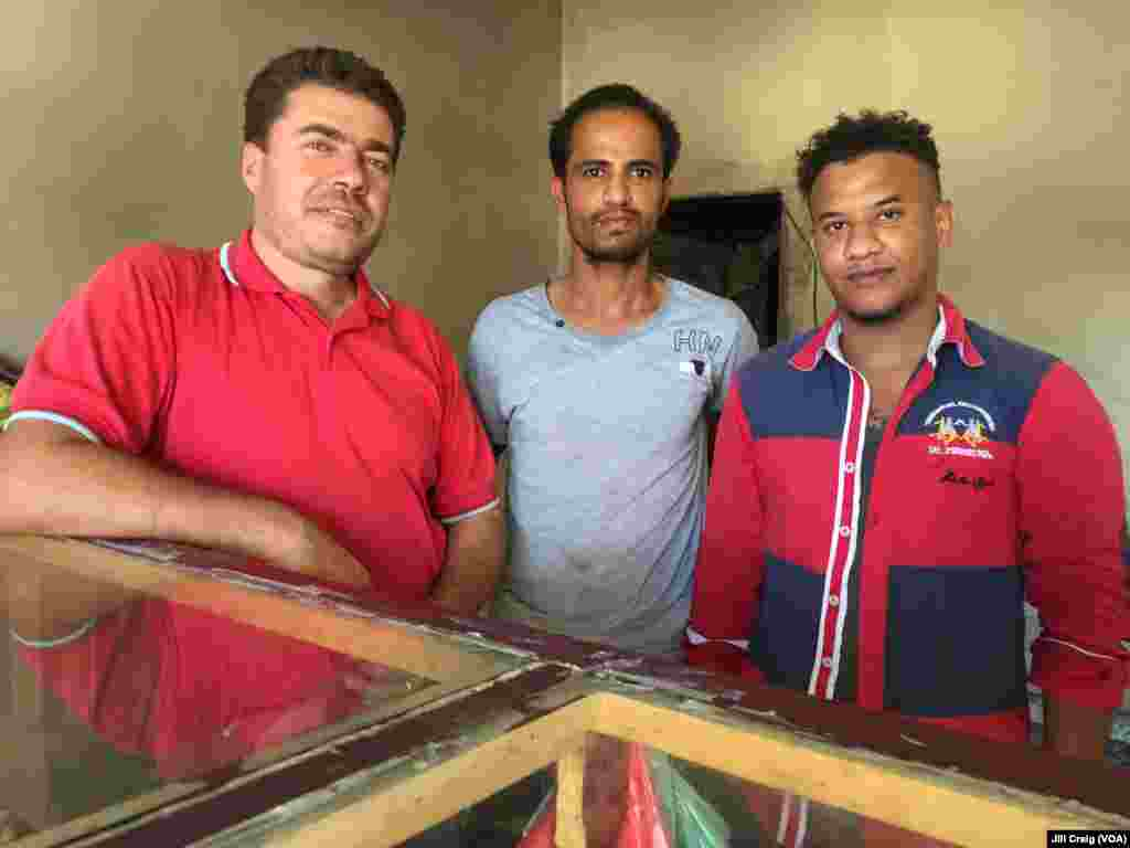 Syrian refugee and bakery owner Abdulrahman Darwish, left, is shown with two Yemeni refugee workers at his bakery in Hargeisa, Somaliland, March 30, 2016.