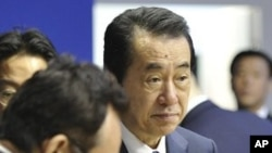 Japanese Prime Minister Naoto Kan, right, participates in a meeting at the G8 summit in Deauville, France, Thursday, May 26, 2011
