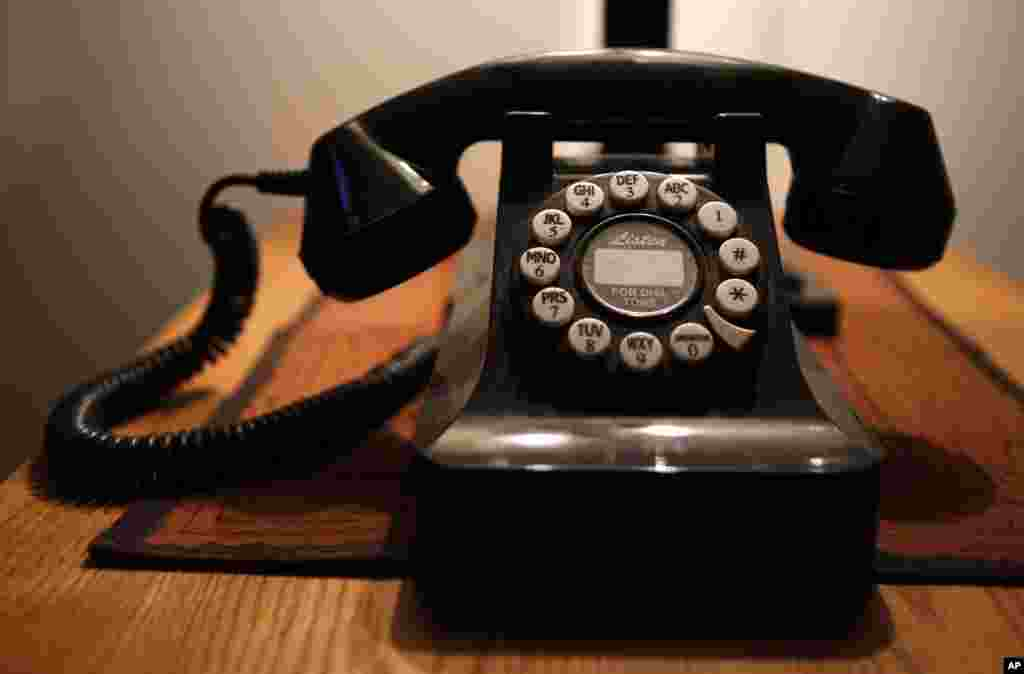 FILE - This Wednesday, April 14, 2016, file photo, shows a push-button landline telephone, in Whitefield, Maine. According to a U.S. government survey released Thursday, May 4, 2017, homes and apartments with only cellphone service exceeded 50 percent for