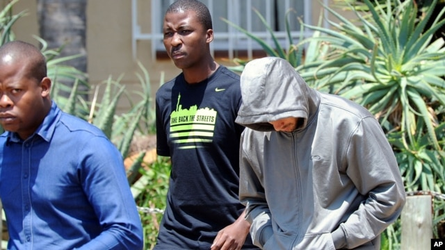 Olympic athlete Oscar Pistorius leaves the Boschkop police station, east of Pretoria, South Africa, Feb. 14, 2013 en route to appear in court charged with murder.