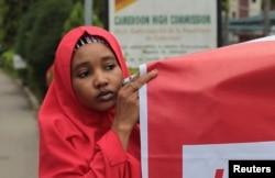 """FILE - Security and women's empowerment are summit themes. A demonstrator at an October """"#Bring Back Our Girls"""" rally calls for the release of girls abducted by Boko Haram militants, outside the Cameroon Embassy in Abuja."""