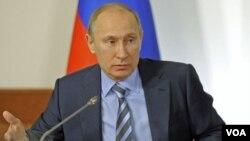 PM Rusia Vladimir Putin menghadiri pertemuan Front Populer Rusia, yang menjadi wadah para pendukungnya di Moskow (27/12).