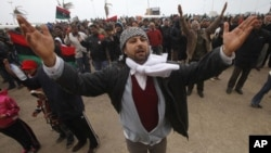 Protesters against the Libyan leader Moammar Gadhafi chant slogans during a demonstration in Benghazi, February 26, 2011