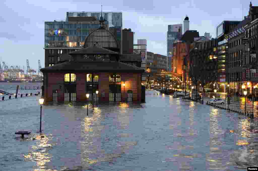 The famous landmark fish market in the harbor of Hamburg, Germany, is seen flooded.