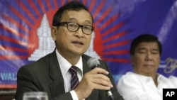Sam Rainsy, who leads the opposition Cambodia National Rescue Party, announced Monday that he would return to the country before the July 28 election.