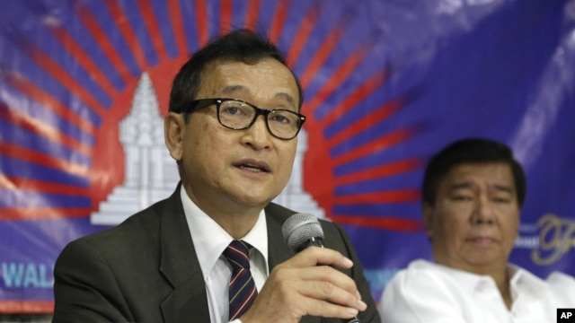 "Cambodian opposition leader Sam Rainsy, left, who is currently living in exile in France, talks about the opposition's plans for next year's elections in Cambodia during the launching of the International Parliamentary Committee for Democratic Elections in Cambodia with Philippine Sen. Franklin Drilon Monday, Sept. 10, 2012, in San Juan, east of Manila, Philippines. Rainsy, who is planning to go back to Cambodia before the July 2013 elections in Cambodia, is leading the opposition and enlisting several parliamentarians from neighboring southeast Asian nations as well as other Asian countries to push for  ""clean and democratic"" elections in Cambodia."