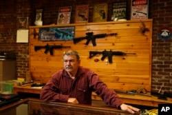 Bob Hagopian works in his gun shop in Maine on Oct. 20, 2016.