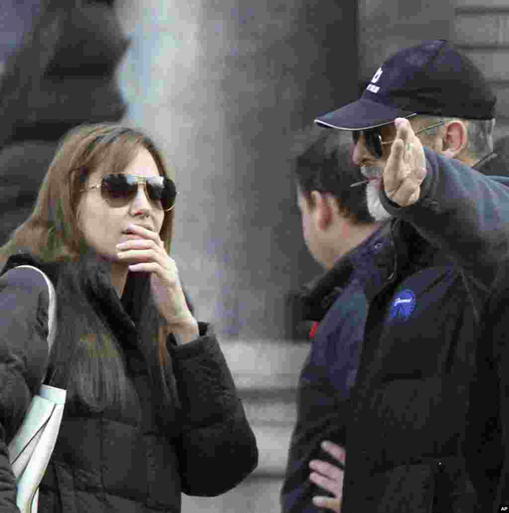 Angelina Jolie talks to cast members during the filming of her movie in central Budapest October 13, 2010. The film was shot partly in Hungary and in Bosnia. (REUTERS)
