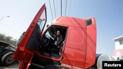 Sales manager Nie Liliang sits in an LNG truck in Yutian county, China