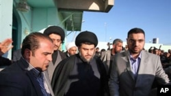 Anti-American cleric Muqtada al-Sadr, center, is surrounded by bodyguards in the Shiite city of Najaf, Iraq, 06 Jan 2011