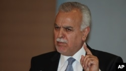 Iraq's Vice President Tariq al-Hashemi speaks to the media during a news conference in Ankara, Turkey, September, 10, 2012.